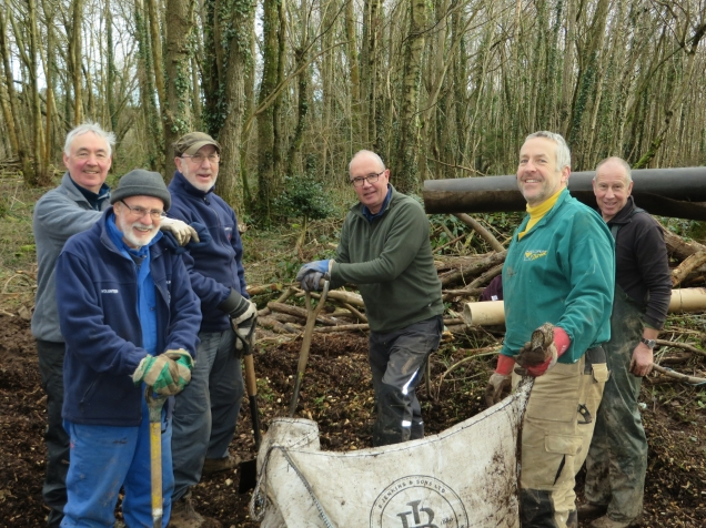 Volunteers building the Orchard Trail through Gilestone Woods